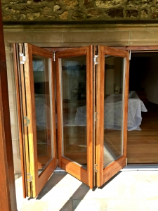Folding sliding doors in solid Oak by James Riggall Fine Joinery of Exeter, Devon