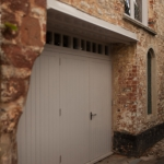 Solid hardwood doors leading to garage of Grade 2 listed building