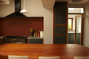 James Riggall Fine Joinery bespoke kitchen with range cooker, bespoke cupboards and large kitchen island