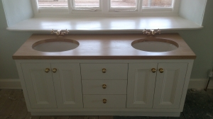 Beautifully designed, vanity unit with double sinks and storage underneath