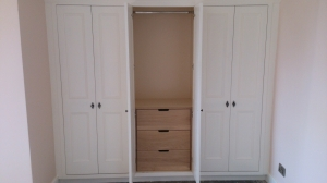 Solid Oak drawers are hidden within the triple wardrobe with hanging rail above, maximising every inch of space