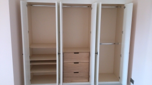 James Riggall Fine Joinery triple space saving bespoke wardrobe
