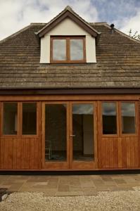 Cottage with hardwood Oak patio doors