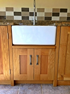 Butler sink set into solid Oak bespoke kitchen unit by James Riggall Fine Joinery, Exeter